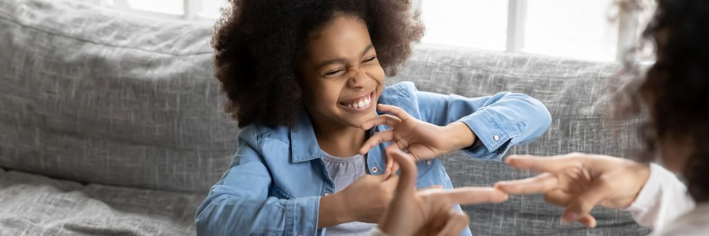 Young girl with a disability using sign language