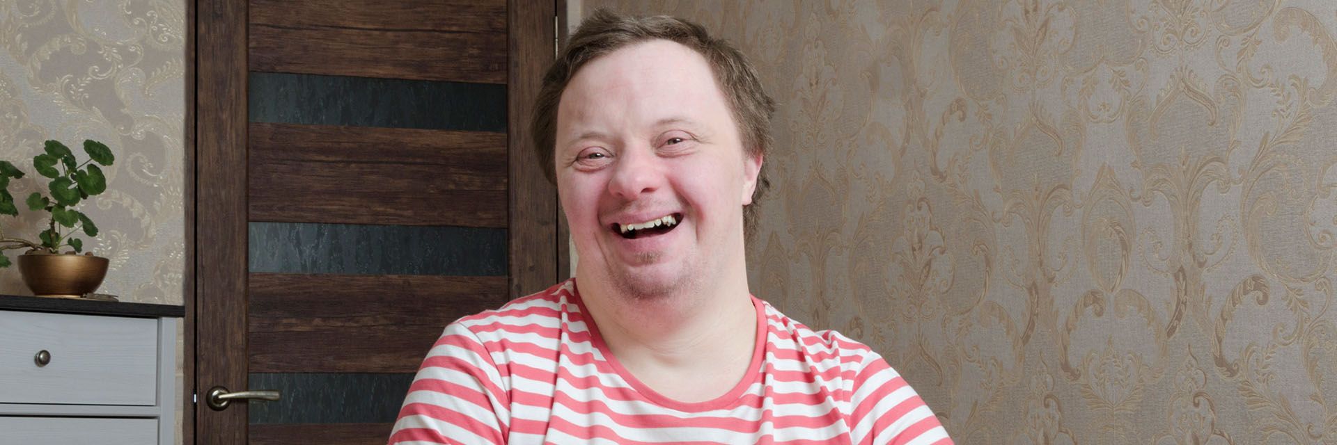 Man with Down syndrome smiling