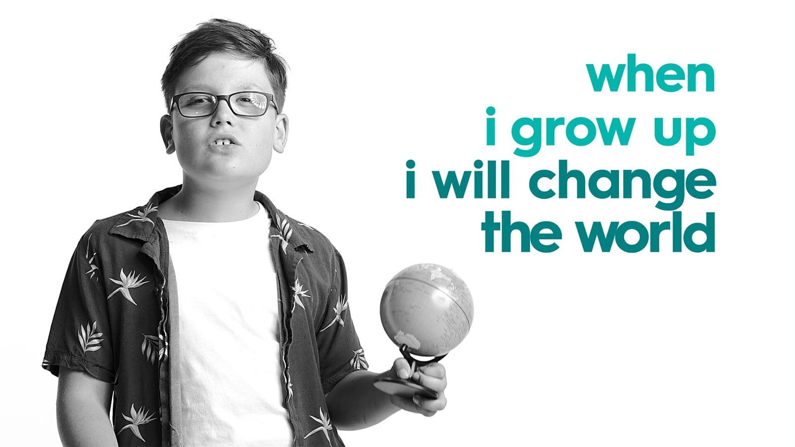 Child with a disability holding a small globe with the words 'when I grow up I will change the world'